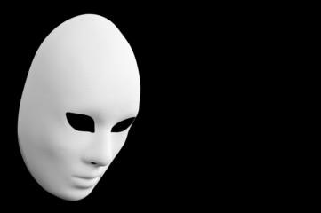 Venetian white mask. Black background.