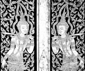 Ancien golden angel picture on the door in Thai temple.