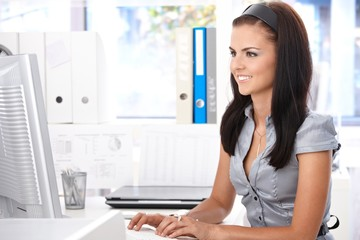 Young office worker at desk