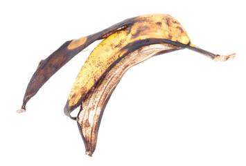 old banana peel , isolated on white background