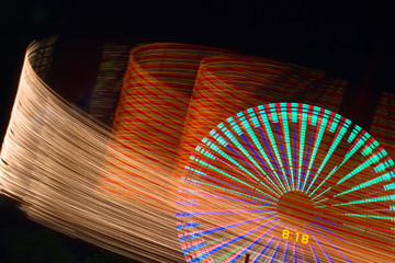 Ferris wheel and lights of the carousel.