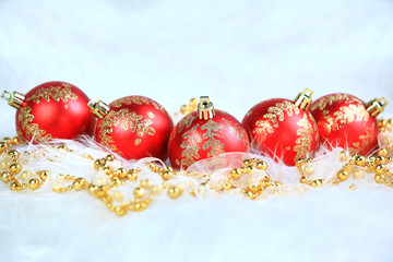 Red christmas balls with snow isolated on white