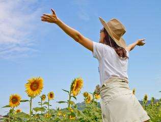 a lady enjoy in sunflower field