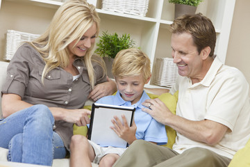 Young Family Parents & Boy Son Using Tablet Computer