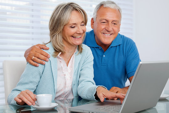 Happy Couple Using Laptop