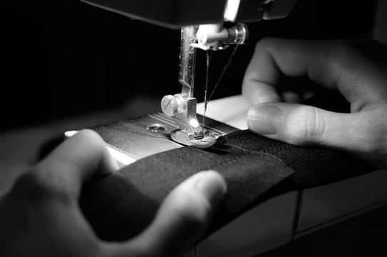 Hands of Seamstress Using Sewing Machine