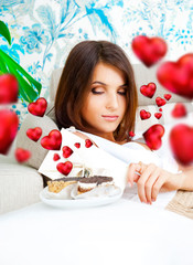 Portrait of young pretty woman eating tasty cakes on Valentines