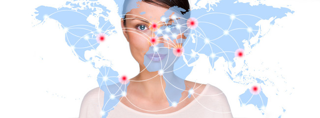 Portrait of young woman standing in fron of big world map and lo