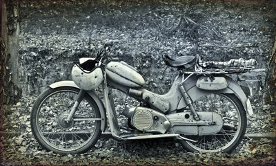 Classic motorcycle on grunge background