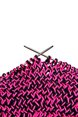 Knitting with pink and black wool