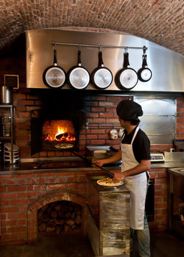 Pizza Chef put the pizza inside the Wood Oven