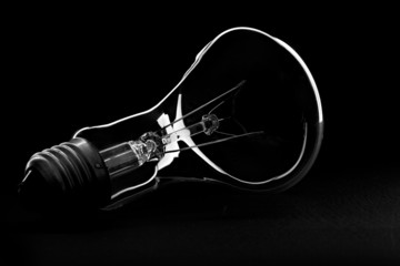 A light bulb silhouette in black