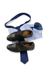 Shoes and shirt with tie on white