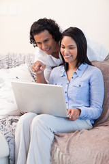 Couple on the sofa surfing the internet together
