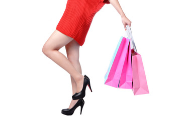 Sexy Legs of shopping lady showing shopping bag