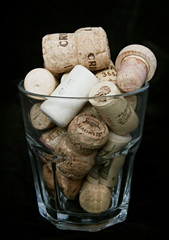cork in a glass isolated on black background