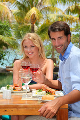 Young couple enjoying lunch in resort restaurant