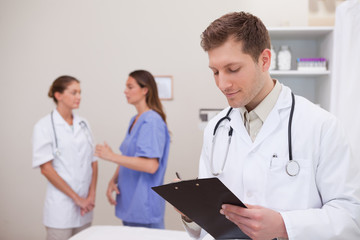 Doctor reading patients record