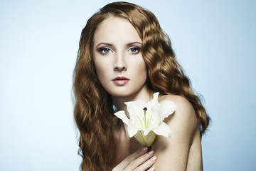 Beautiful portrait of young sensual woman with flower