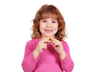 Wall Mural - cute little girl eat cookie