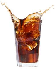 Fototapeta Ice cube droped in cola glass and cola splashing