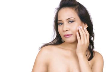 Beautiful asian woman applying face cream