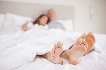 Lovely couple lying in a bed