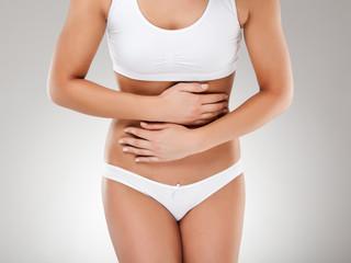 Woman massaging pain stomach
