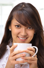 Beautiful businesswoman drinking coffee in the office.