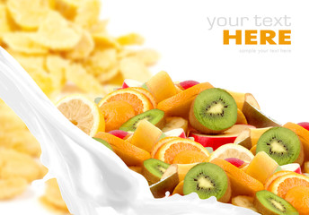 Milk splash with fruit mix on corn flakes background