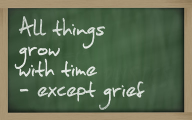 """ All things grow with time - except grief "" written on a blackb"