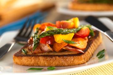 Baked asparagus, mango, tomato, carrot, bacon sandwich