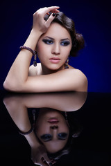 girl at mirror table