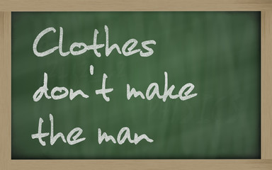 """ Clothes don't make the man "" written on a blackboard"