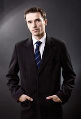 Handsome man portrait, male model in suit, studio shot