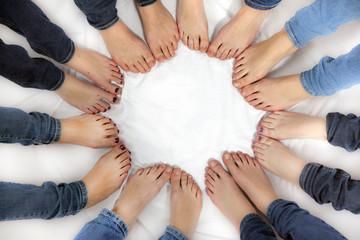 feet of girls form a circle