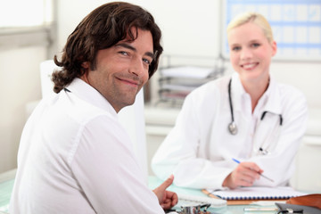 man chatting with a nurse