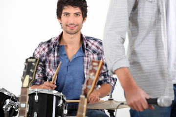 Young man playing drums