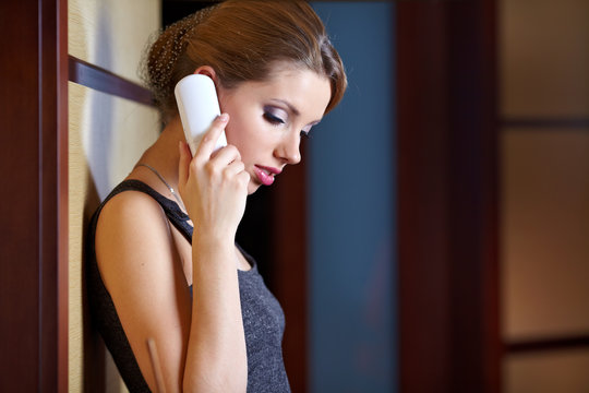 A young woman flirting and chatting on the phone
