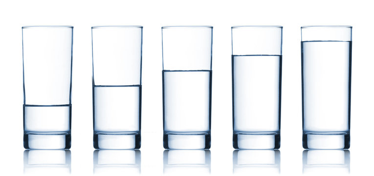 set of glasses filled with water