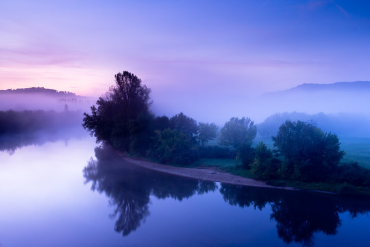 The Dordogne misty river at sunrise