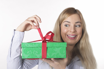 A young woman looks forward with the gift