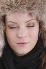young beautiful woman with a winter cap (closed eyes)