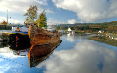 Old rusty boats on Caledonian Canal, Scotland