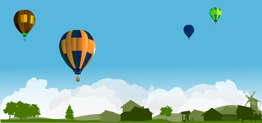 balloons above country landscape