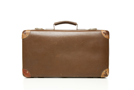 Vintage leather suitcase isolated on white