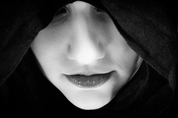 Woman with black hood, focus on her lips