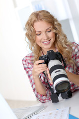 Photographer looking at photo camera