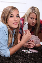 Teenagers playing cards