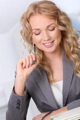 Portrait of beautiful blond businesswoman in office